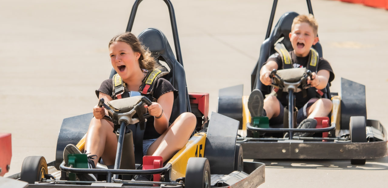 Brother and sister go-carting