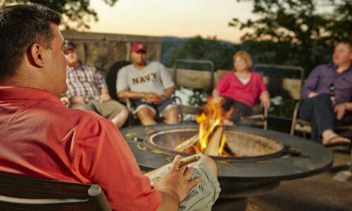 People sitting at a firepit