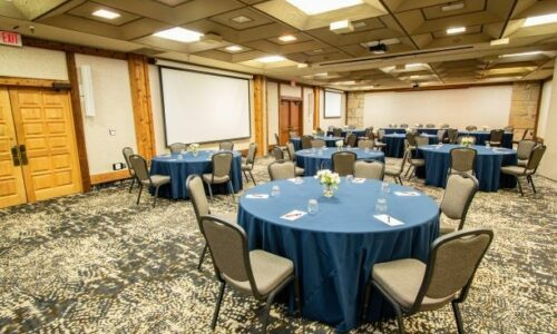 Conference room setup with round tables