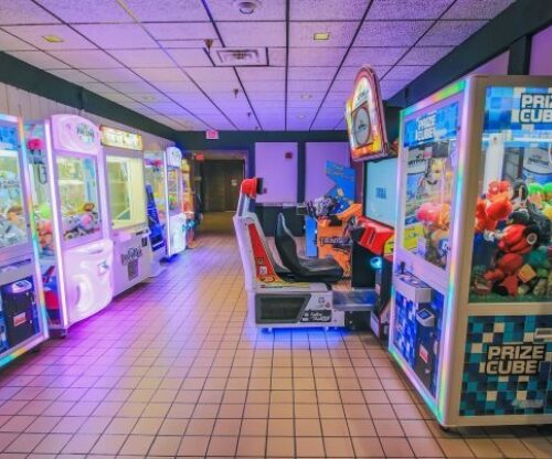 Arcade games lit up with neon lights