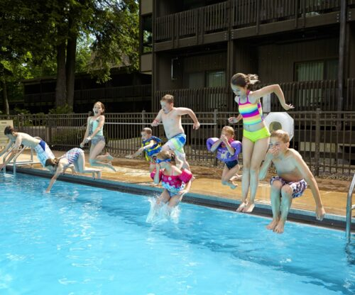 Outdoor Pool with kids jumping in