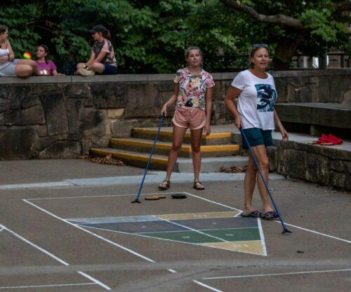 Family playing shuffleboard