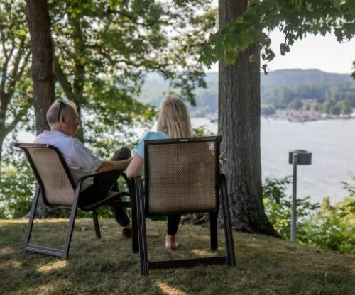 Couple in lawn chairs overlooking the lake