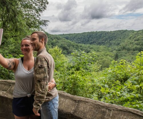Couple taking a photo together overlooking Clear Fork Gorge